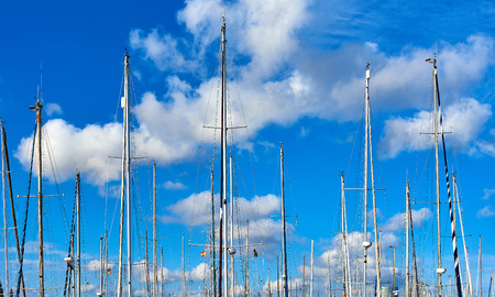 shrouds: Ship masts against blue cloudy sky. Port of Barcelona, Spain Stock Photo