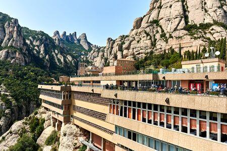 Montserrat, Spain - April 6, 2016: Spectacular view of Montserrat mountains and The Benedictine abbey of Santa Maria de Montserrat. Catalonia, Spain