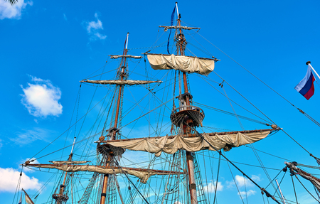 frigate: Masts of the frigate against blue sky