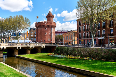 View to the Canal and Castle of Perpignan in springtime. Pyrenees-Orientales, France Editorial