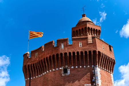 The Castillet against blue sky, is a small fortress built in the 14th century. Perpignan, France
