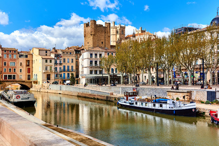thoroughfare: Narbonne, France - April 8, 2016: The Canal de la Robine in Narbonne city. Languedoc-Roussillon, France. Classed as a UNESCO world heritage site, the Canal de la Robine is the main thoroughfare which gives the town its heartbeat Editorial