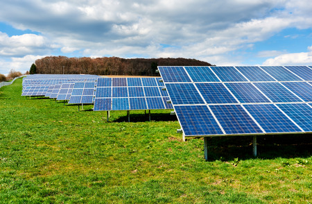 Solar panels on a green field Stock Photo