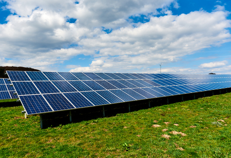 Solar panels on a green field Stock Photo