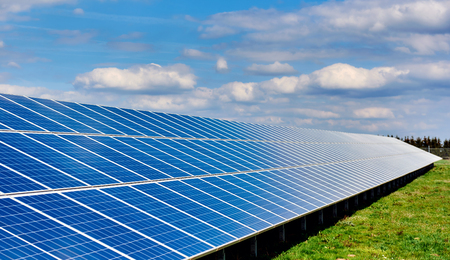 solar array: Solar panels on a green field Stock Photo