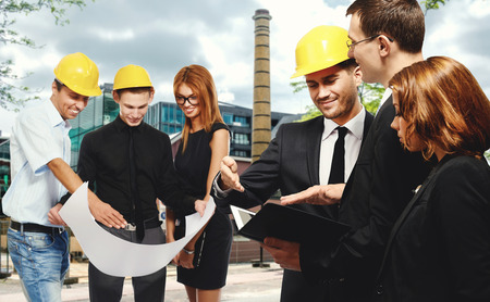 businesswear: Construction team at business meeting, outdoors