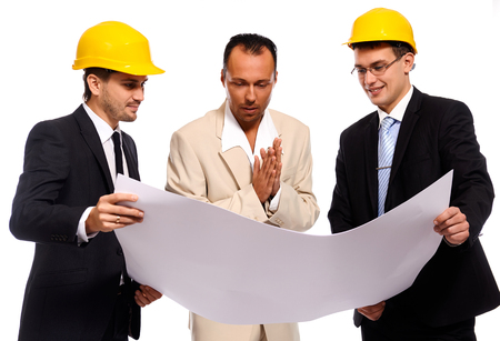 businesswear: Construction team at business meeting. Studio shot, white background