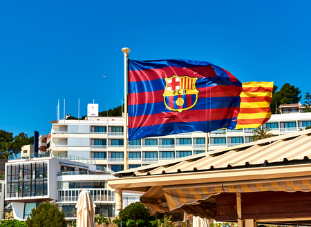 futbol: Waving flag of FCB (Futbol Club Barcelona). Tossa de Mar town. Catalonia, Spain
