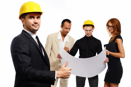 thumbs up sign: Construction team at business meeting. Studio shot Stock Photo