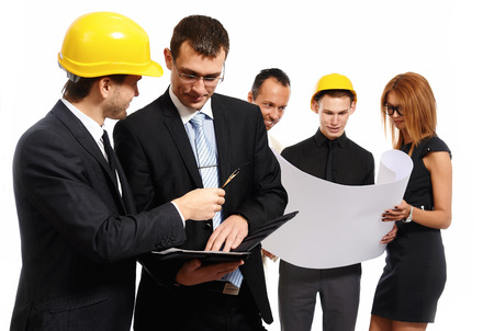 businesswear: Construction team at business meeting. Studio shot Stock Photo