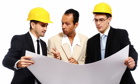 construction team: Construction team at business meeting. Studio shot, white background