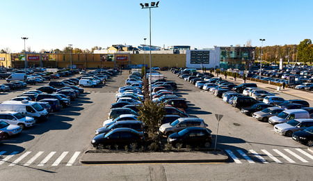 parking space: Riga, Latvia - October 17, 2016: Cars parked in a parking lot at shopping sentre Spice in Riga city. Northern Europe. Latvia
