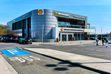 mcdonalds: Luxembourg - April 4, 2016: Building on the border of Luxembourg and France.   McDonalds restaurant, Starbucks Coffee and Shell logos. Western Europe