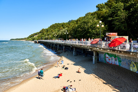 baltic people: Svetlogorsk, Russia - July 16, 2016: View to the seafront promenade and sunbathing people on the coast of Baltic Sea. Resort city of Svetlogorsk in Kaliningrad region. Russia Editorial