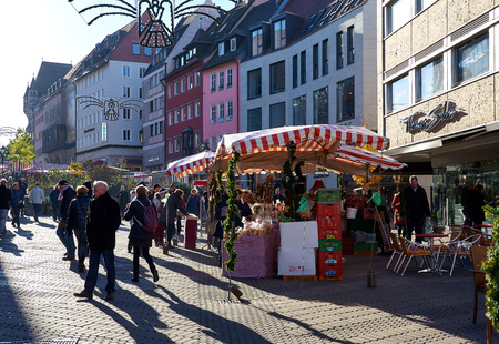 fairs: Nuremberg, Germany - November 29, 2016: Crowd of people on a Nurembergs Christmas Market, one of Germanys oldest Christmas fairs. Bavaria, Germany Editorial