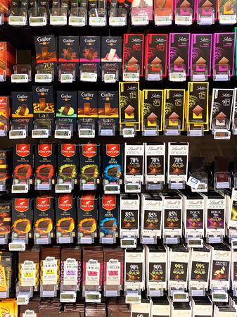 carrefour market: Orange, France - December 1, 2016. Variety of chocolates on shelves in a Carrefour supermarket. It is one of the largest hypermarket chains in the world Editorial