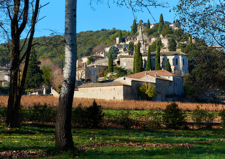 rocky peak: La Roque-sur-Ceze, it is very picturesque village on a rocky peak in southern France. This place classified as one of the most beautiful villages in France