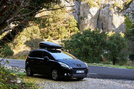 Provence, France - December 2, 2016: Black colour Peugeot 5008 stopped on a mountain road in France The Peugeot 5008 is a French car and has been on sale since November 2009