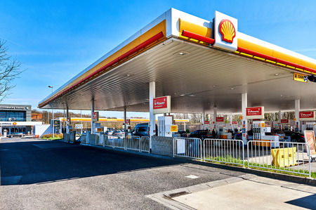 Luxembourg - April 10, 2016: Shell gas station on the border of Luxembourg and France. The cheapest fuel in Central Europe. Shell is an Anglo-Dutch multinational oil and gas company headquartered in the Netherlands and incorporated in the United Kingdom.