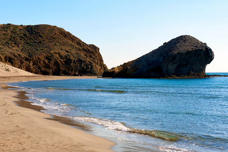 monsul: Volcanic rock-formations and crystal clear water at Playa de Monsul. Famous beach in the Cabo de Gata-Nijar Natural Park. Province of Almeria. Spain Stock Photo