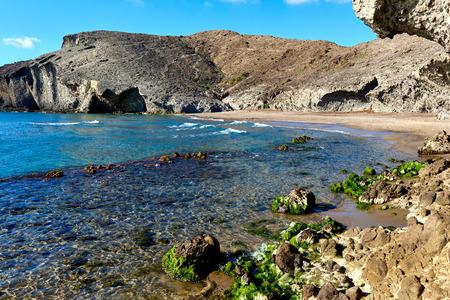 Volcanic rock-formations at Playa de Monsul. Famous beach in the Cabo de Gata-Nijar Natural Park. Province of Almeria. Spain