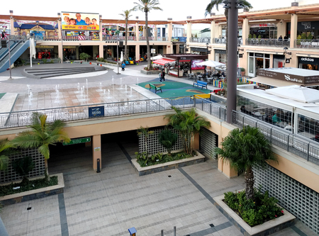 occupying: Orihuela, Spain - January 10, 2017: Inside of La Zenia Boulevard shopping centre. Occupying over 160,000 square metres, with 150 shops and restaurants. La Zenia Boulevard is the largest Shopping centre in the province of Alicante. Spain
