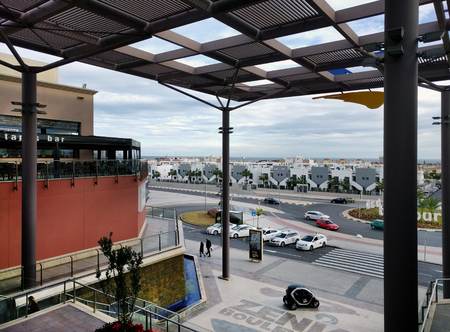occupying: Orihuela, Spain - January 10, 2017: La Zenia Boulevard shopping centre. Occupying over 160,000 square metres, with 150 shops and restaurants. La Zenia Boulevard is the largest Shopping centre in the province of Alicante. Spain