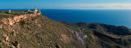 Panorama of a Mesa Roldan Lighthouse and beautiful mountains. Cabo de Gata-Nijar Natural Park, Almeria province, Andalusia, Spain Stock Photo