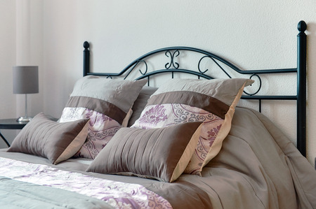 bedstead: Pillows on bed in bedroom