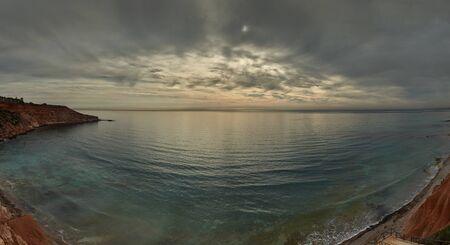 seaside resort: Moody sky over the Mediterranean Sea in Dehesa de Campoamor. Campoamor is a popular seaside resort on the south Orihuela Coast, located on the border of the Costa Blanca and Costa Calida. Spain