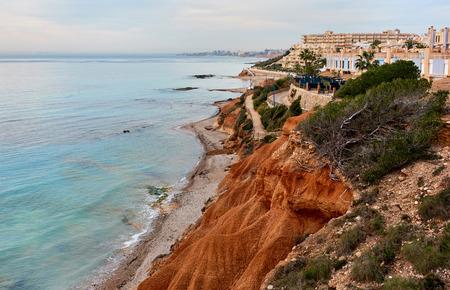 Rocky coast of Dehesa de Campoamor. Campoamor is a popular seaside resort on the south Orihuela Coast, located on the border of the Costa Blanca and Costa Calida. Spain