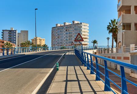 The 53 m long Bascule bridge of La Manga (La Manga del Mar Menor), in summer timetable it raises eight times a day. Region of Murcia, Spain. Stock Photo