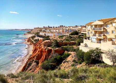 seaside resort: Rocky coast of Dehesa de Campoamor. Campoamor is a popular seaside resort on the south Orihuela Coast, located on the border of the Costa Blanca and Costa Calida. Spain