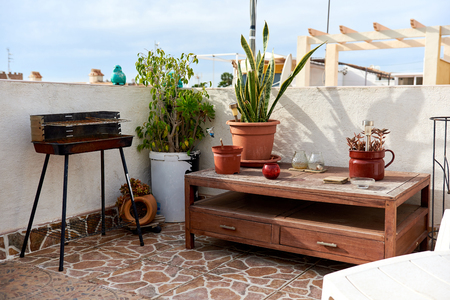 spanish home: Nice summer terrace with barbecue