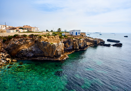 Rocky coastline of Tabarca Island. Crystal-clear turquoise water. Province of Alicante. Spain
