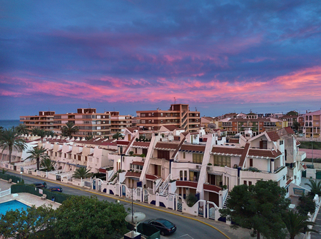 realestate: Typical spanish urbanization at sunset. Torrevieja. Alicante province, Spain Stock Photo
