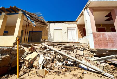 Damaged beach houses. The wind and waves is washed away the beach houses on the Babilonia beach. Guardamar del Segura. Province of Alicante. Spain Editorial