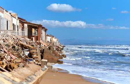 Damaged beach houses. The wind and waves is washed away the beach houses on the Babilonia beach. Guardamar del Segura. Province of Alicante. Spain Stock Photo