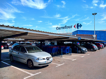 Torrevieja, Spain - March 17, 2017: Parking and facade of Carrefour hypermarket. Carrefour is a French multinational retailer, and one of the largest hypermarket chains in the world