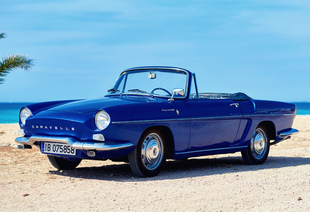 Villajoyosa, Spain - May 28, 2017: Renault Caravelle or Renault Floride car on the tropical beach. It is a sports car which was produced by the French manufacturer Renault between 1958 and 1968 Editorial
