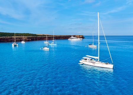 picturesque: Sailboats at Cala Salada lagoon. Stock Photo