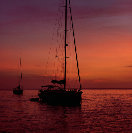 picturesque: Yacht at Cala Saona in Formentera during the colorful sunset. Idyllic scenery. Balearic Islands. Spain