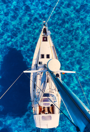 Yacht and clear Mediterranean sea, view from the mast. Formentera. Balearic Islands. Spain