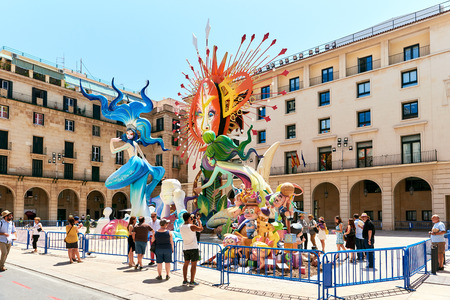 Alicante, Spain - June 20, 2017: Preparation for The Bonfires of Saint John holiday in the Alicante city. Decorations, are structures made of cardboard, wood or cork, which are exhibited in the streets of Alicante during the festival and are set on fire o