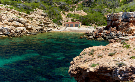 Picturesque beach of Punta Galera, is an amazing bay surrounded by stone formations. Balearic Islands. Spain
