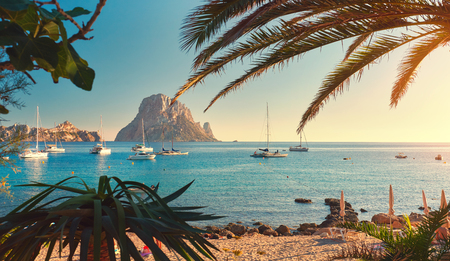 Cala dHort beach. Cala dHort in summer is extremely popular, beach have a fantastic view of the mysterious island of Es Vedra. Ibiza Island, Balearic Islands. Spain