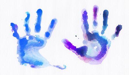 白い背景に絵の具で手形