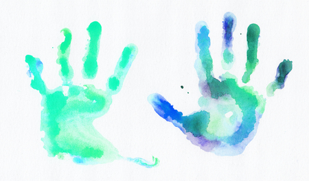 Watercolor handprints over white background Stock Photo