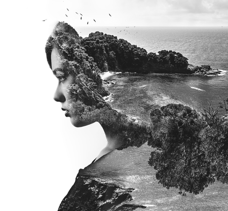 Double exposure. Portrait of a woman combined with a rocky coast and sea. Black and white Stok Fotoğraf