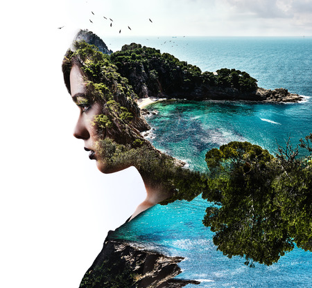 Double exposure. Portrait of a woman combined with a rocky coast and sea Banco de Imagens